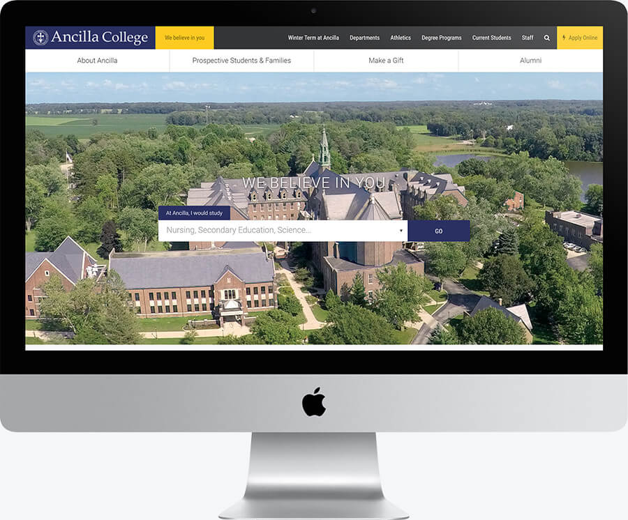 A desktop computer showing the hero section of the Ancilla College website