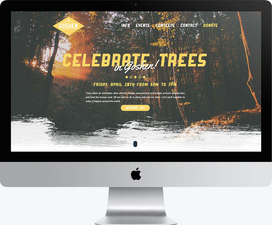 An image of a desktop computer displaying the homepage of Goshen Arbor Day
